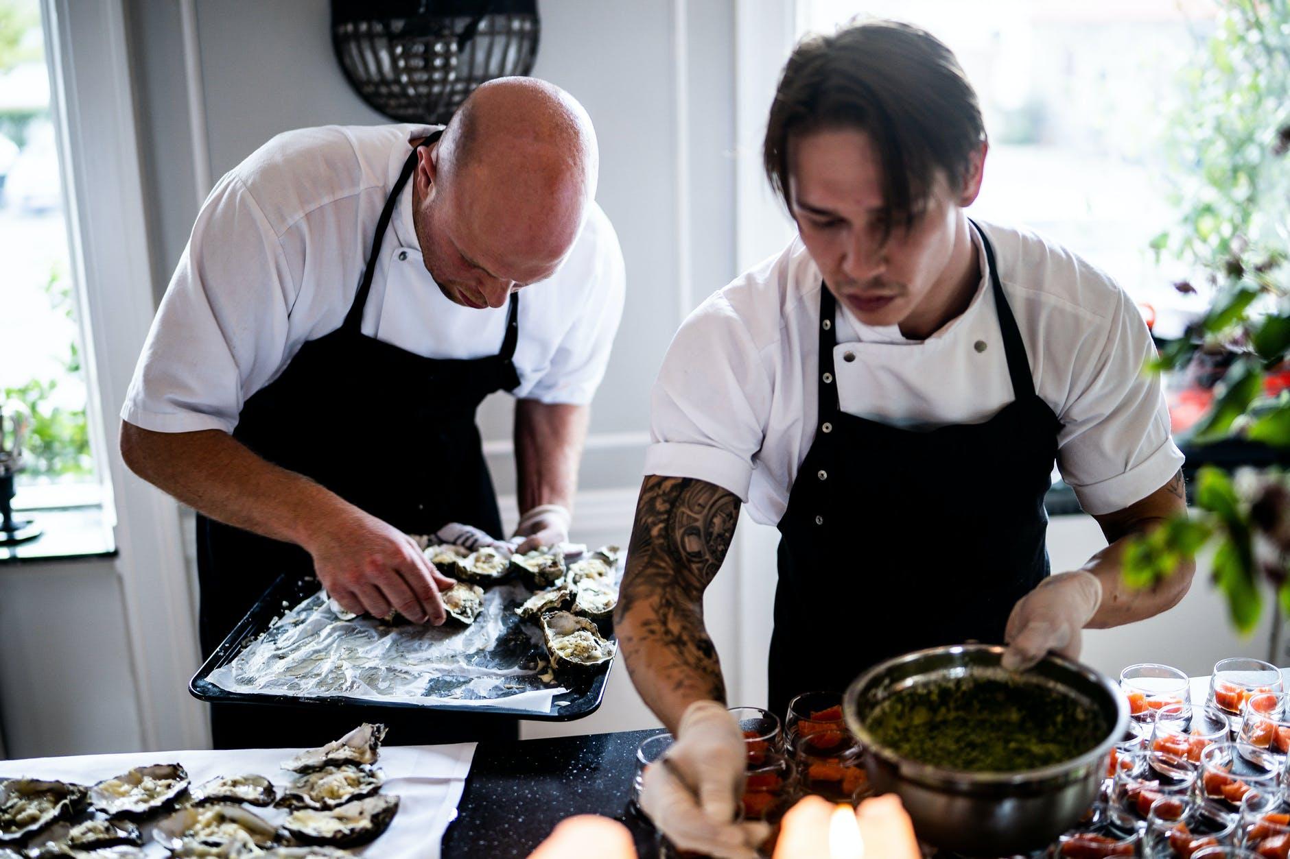 two men preparing food