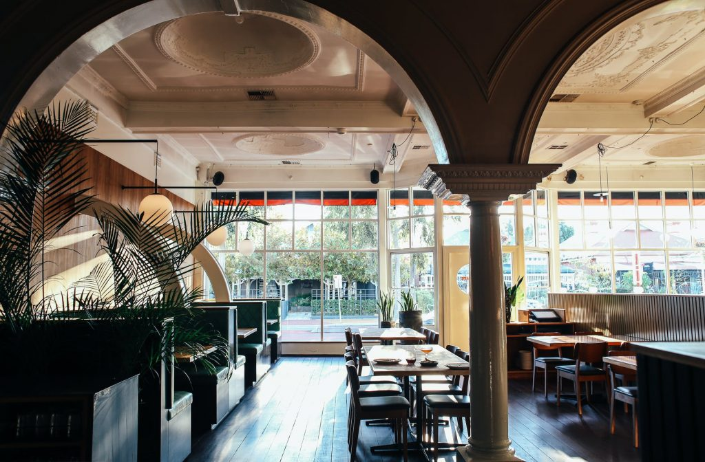 interior on spacious classy restaurant with arches in daylight